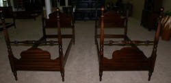 Kindel matched pair of mahogany twin poster beds