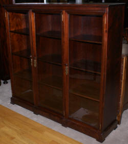 Mahogany antique inlaid 1920s triple glass door bookcase