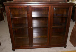 Dark mahogany triple glass door bookcase