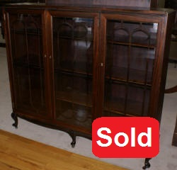 Petite walnut triple glass door antique bookcase