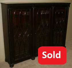 Empire Revival mahogany triple glass door bookcase