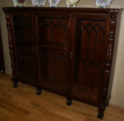 R.J. Horner inlaid mahogany triple arched door antique bookcase