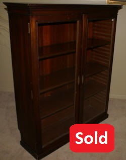 Antique walnut two door bookcase with slide in shelves