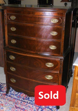 mahogany serpentine front high chest