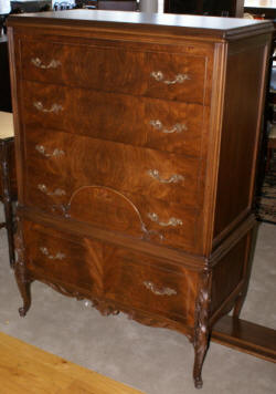 Walnut antique inlaid French carved chest of drawers
