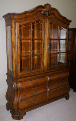 Dark mahogany bow front china cabinet
