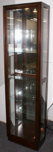 Dark mahogany curio cabinet by Pulaski Furniture Company