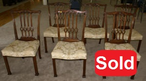 Nice set of solid mahogany ribbon back dining room chairs