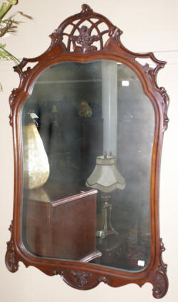 heavily carved antique French carved mirror