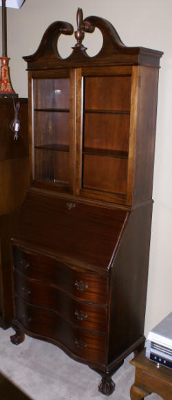 mahogany antique serpentine front secretary desk