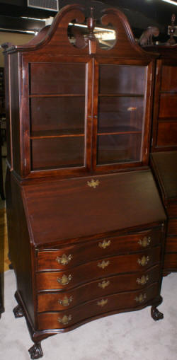 Black antique serpentine front secretary desk