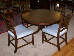 mahogany round table and 4 baker dining room chairs