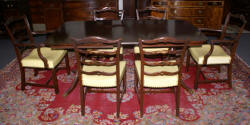 Mahogany Duncan Phyfe dining room table and set of six ribbon back dining room chairs