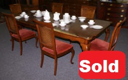 solid cherry table and six cane back chairs