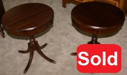 Matched pair of round mahogany living room tables